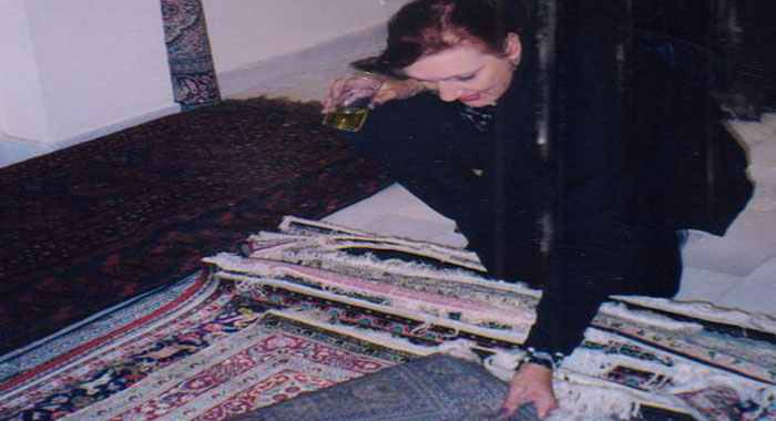 Jane choosing her favorite rug for the bedside